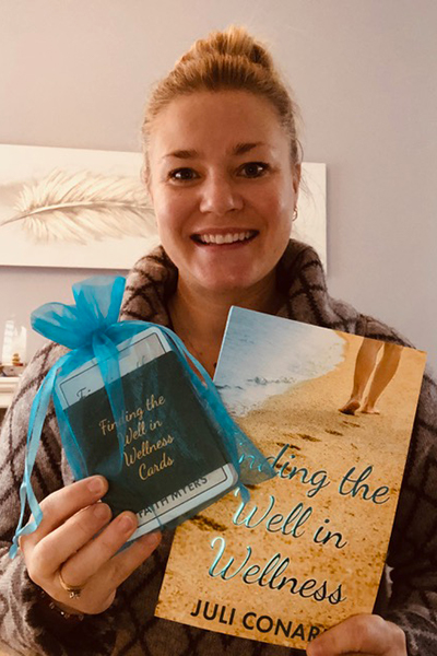 Finding the Well in Wellness Bundle Photo - Juli Conard holding the book and cards